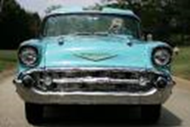 Classic Blue 1957 Chevy Bel Air.  Do you see a face?  Most people see headlights as the eyes, air intake/grille as the mouth, and a nose somewhere in more than 50 percent of the cars
